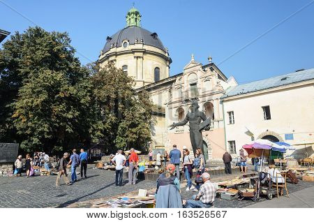 Lviv Ukraine - September 08 2016: Book Fair at the monument to Ivan Fedorov in Lviv sunny autumn day. Ivan Fedorov (1525-1583) was the first printer in Russia and Ukraine.