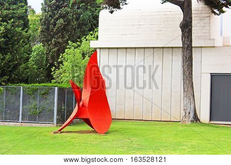 BARCELONA, SPAIN - OCTOBER 08, 2013: Red statue of Miro in Barcelona, Spain. The red statue is located at the entrance to the Museum and Foundation Joan Miro in Montjuic mountain, Barcelona