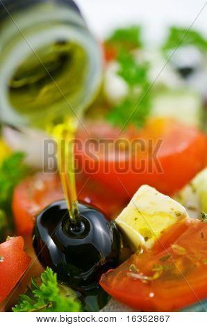 olive oil in salad closeup