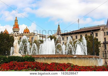 Fountain at Catalonia Square in Barcelona, Spain. Some of most important streets and avenues meet at here. Center of business and cultural life