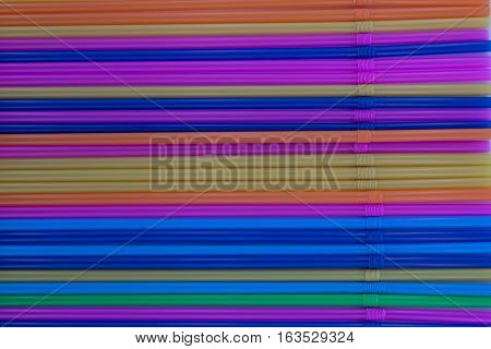 Colorful drinking plastic straws as a background pattern