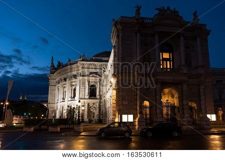Beautiful view of historic burgtheater imperial court theatre in the evening and cars on street, vienna, austria