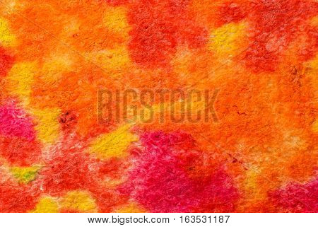 Multicolor abstract fabric texture of wool with stains . Craft background