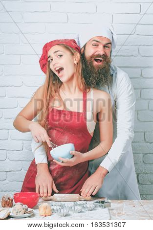 Baker Cooking Cakes With Girl