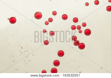 Red bubbles soars over a light grey background