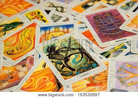 Moscow, Russia - December 4, 2016: Tarot card Devil with other cards. Rider-Waite tarot deck. Esoteric background