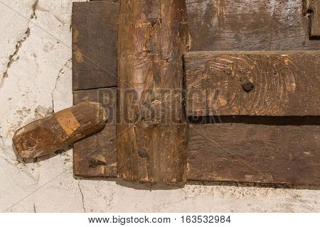 Wooden latch for an old window detail locks Wood with signs of woodworm vintage