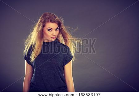 Attractive Blonde Woman With Windblown Hair