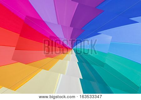 multicoloured wedges  seem a vortex of colours / effect  droste of multicoloured background