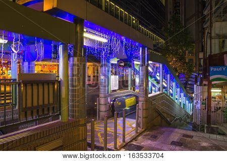 Hong Kong, China - December 10, 2016: popular Central-Mid-Levels escalator in Shelley and Staunton Street by night, Soho district, Central Hong Kong, famous for bars, restaurants, clubs and nightlife.