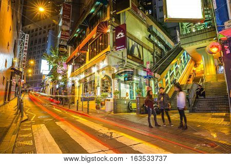Hong Kong, China - December 10, 2016: People in front of entrances of Central-Mid-Levels escalator between Elgin and Shelley St, in Soho, famous historic district for bars, restaurants and nightlife.