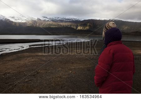 CONGUILLIO-03 MAY 2015: A couple of Chilean look the horizon and wait the sunset in the Conguillio Park near Melipeuco on May 3, 2015. Chile