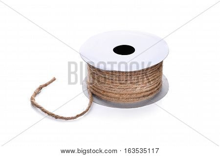 hemp rope in paper roll isolated on white background