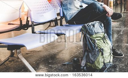 Single Traveler, Backpacker Waiting For Long Journey Travel At Train Station With Backpack. Travel C