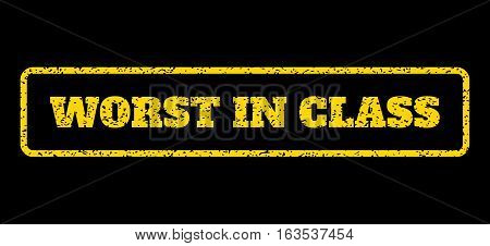 Yellow rubber seal stamp with Worst In Class text. Vector caption inside rounded rectangular shape. Grunge design and scratched texture for watermark labels. Horisontal emblem on a blue background.