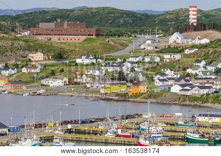 Small village community, Twillingate, Newfoundland.  Fishing boats docked along the shoreline in this coastal town, local roads connect the community along the Island's edges.