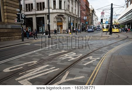 Manchester United Kingdom - September 20 2016: People walking and shopping at Market Street in the city of Manchester United Kingdom.