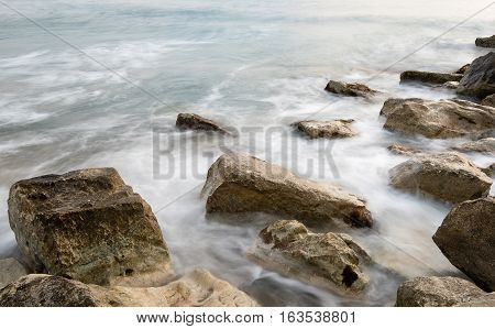 Sea water waves crashing on the rocks