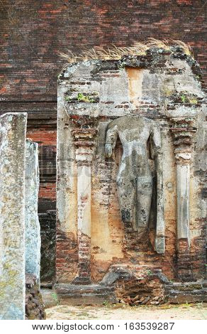 Statue in Polonnaruwa temple - medieval capital of Ceylon, UNESCO World Heritage Site