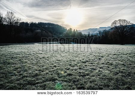 Landscape picture of Kammerhof in Pielachvalley in winter with direct backlight