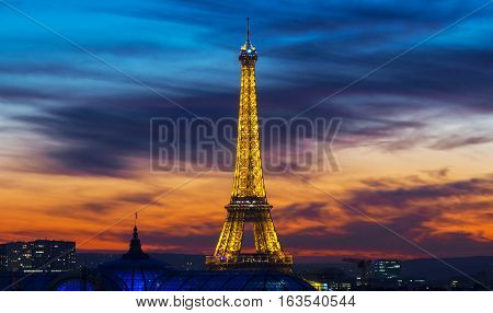 Paris France-December 28; 2016 : The famous Eiffel tower at sunset.It is one of the most visited monuments in the world located on Champ de Mars in Paris France.