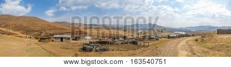 Wide panorama of simple stone and tin huts in a village in the mountain kingdom of Lesotho, Africa