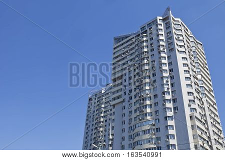 Real estate. Large multi-storey building on a blue sky