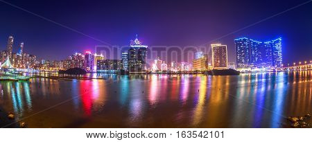 Macau, China - December 9, 2016: Panorama of Macao business district with Wynn Macau and Casino Lisboa, popular casino from Nam Van Lake, a man-made lake in the southern end of Macau Peninsula.