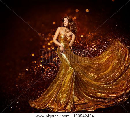 Fashion Woman Gold Dress Luxury Girl in Elegant Golden Fabric Gown Flying Sparkles Cloth