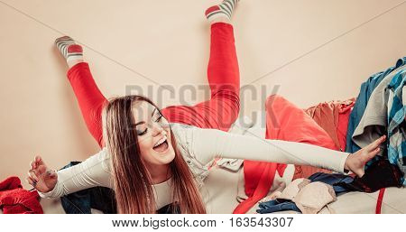 Woman Lie On Sofa Full Of Clothes.