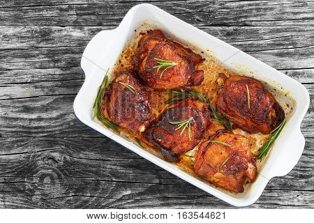 Rilled Chicken Thighs With Rosemary And Spices In Roasting Dish