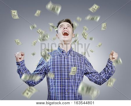 Raining money over neutral background - Young man success