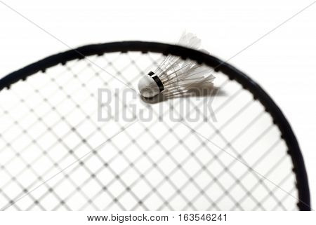 The Badminton racket and shuttlecock on white background