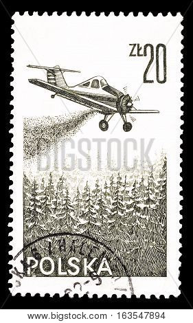 POLAND - CIRCA 1977 : Cancelled postage stamp printed by Poland, that shows Airplane putting out forest fire.