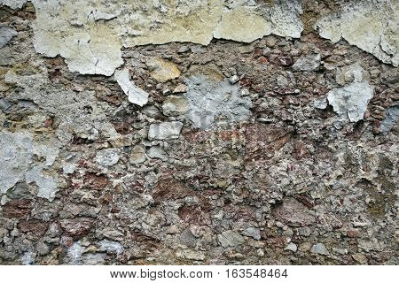 Close up view of crumbling plaster brick wall texture