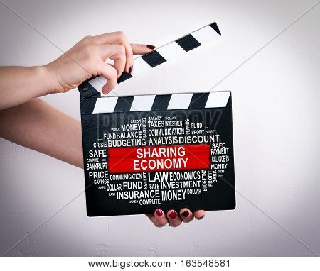 Sharing economy Concept. Female hands holding movie clapper.