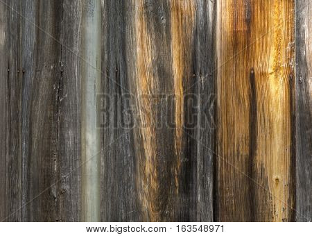 This colorful wood siding of a worn and weathered barn in the mountains of southeastern Arizona make a beautiful background or texture.