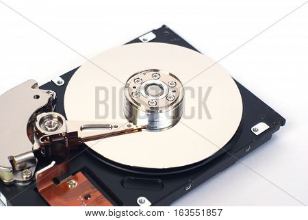 Opened computer hard disk drive isolated on white closeup