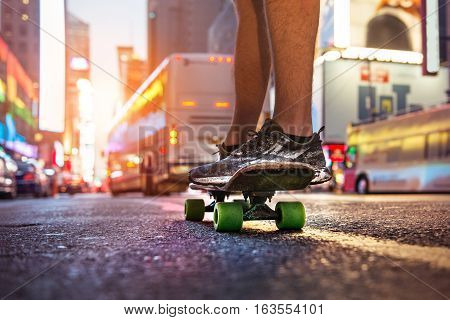 Man enjoy the riding on skateboard on city street at sunset time. Skateboarder people sport concept theme.