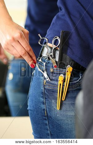 Hand Of Female Hairdresser Hold Or Pick Scissors From Jeans Pocket
