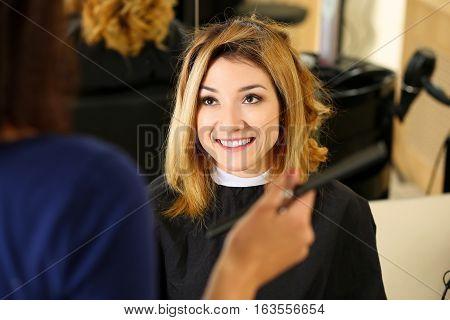 Female Hairdresser Hands Holding Comb Picking New Hairdo