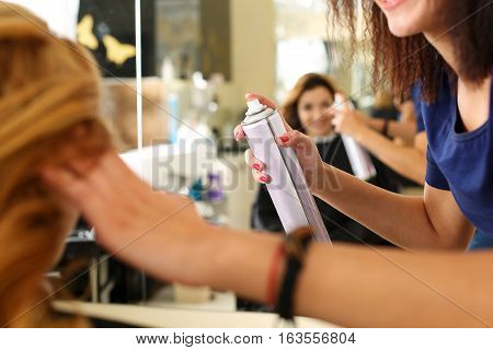 Hand Of Female Hairdresser Holding Spray Can