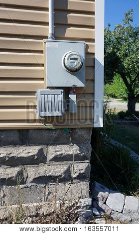 HARBOR SPRINGS, MICHIGAN / UNITED STATES - AUGUST 3, 2016: A Schlumberger watthour meter measures the electricity usage of a house in Harbor Springs.