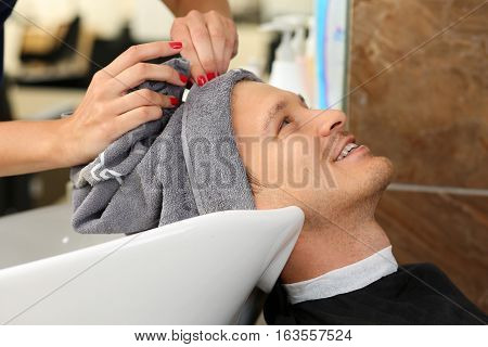 Female Hands Wiping Hair Of Handsome Smiling Man With Towel