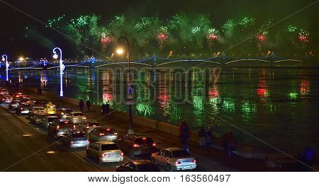 ST.PETERSBURG, RUSSIA - DECEMBER 30, 2016: Christmas atmosphere in St. Petersburg. Pyrotechnic show on the embankment and the Troitskiy bridge.Colourful grand fireworks devoted to end of Year 2016