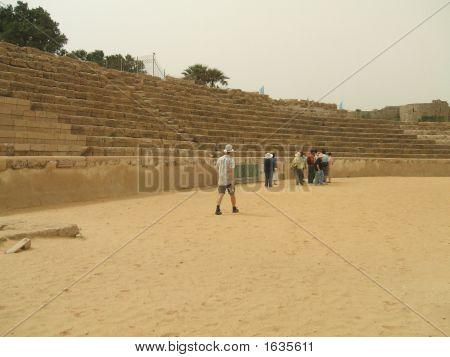 Tourists In The Old Roman Theatre In Caesarea