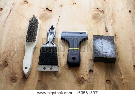 Row of Sanding Tools on Wooden Background