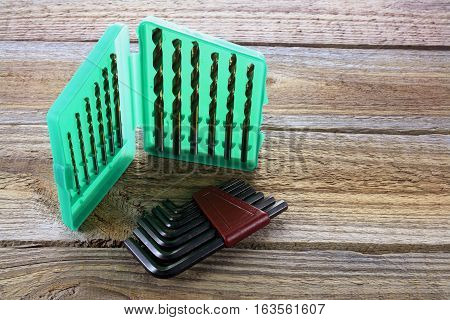 Drill Bit Set and Alllen Keys on Wooden Background