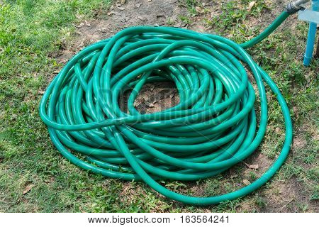 Rubber tube for watering plants in the garden
