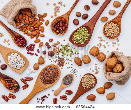 Various Kind Legumes And Nutshells In Spoons And Hemp Sack Bags. Walnuts Kernels ,hazelnuts, Almond